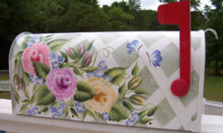 3 multi-colored roses on a trellis background with butterflies