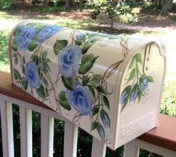 blue roses on white mailbox