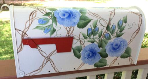 blue roses on a trellis