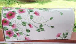 climbing wild roses on white hand painted mailbox