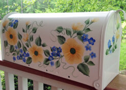 hand painted mailbox with yellow roses