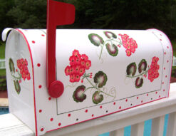 red geraniums hand painted mailbox with polka dots