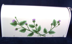 thistles painted on a post mount mailbox