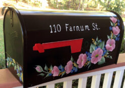 wild roses painted mailbox pink, yellow and purple