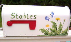 dandelions and butterflies hand painted on a post mount mailbox