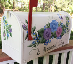 front side of Fairies and Flowers hand painted mailbox