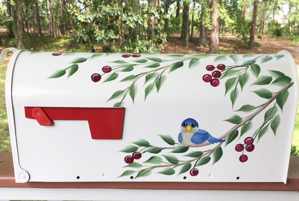 hand painted blue bird and cherry tree mailbox