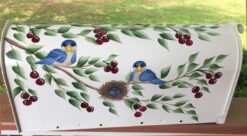 painted mailbox with bluebirds in a cherry tree