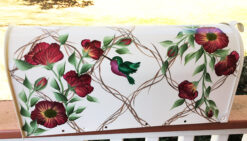 hand painted mailbox with hummingbird and wild roses