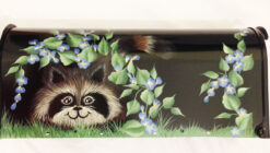 Raccoon hand painted mailbox on a black post mount