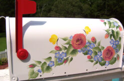 roses and periwinkle garland hand painted on a white post mount mailbox