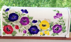 hand painted mailbox with vibrant colored pansies