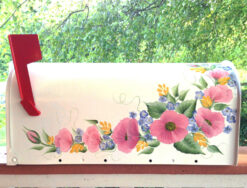 hand painted mailbox with roses pink blue and yellow
