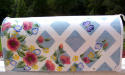 roses and butterflies on lattice hand painted mailbox with blue background