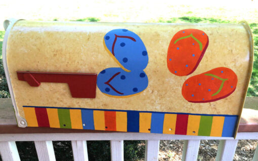 hand painted mailbox with colorful flip flops
