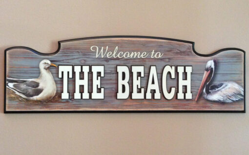 sign reads, welcome to the beach