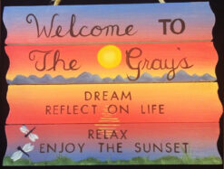 hand painted welcom and relax sign with sunset