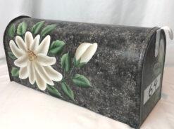 single large magnolia on gray