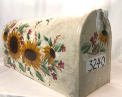 mailbox with sunflowers painted on a beige sponged painted background