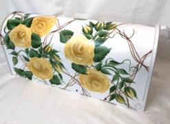 yellow roses on vine trellis